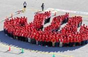 日本日光一小学466人组成温泉标志创吉尼斯纪录